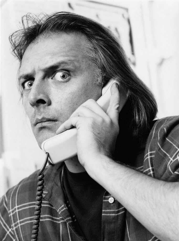 Rik Mayall on the telephone, photograph taken by Mark Young