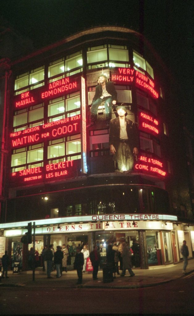 The Queens Theatre lit up at night when Rik Mayall and Ade Edmondson were appearing in the play Waiting For Godot