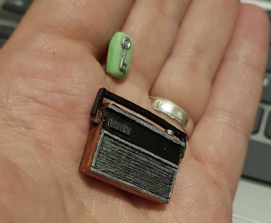 Miniature radio and key in bar of soap from the mini Bottom flat
