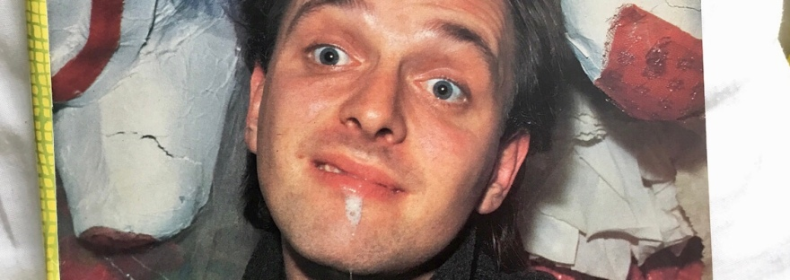 Rik Mayall dribbling picture from Kerrang magazine