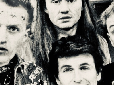 The cast of the young ones stood outside house