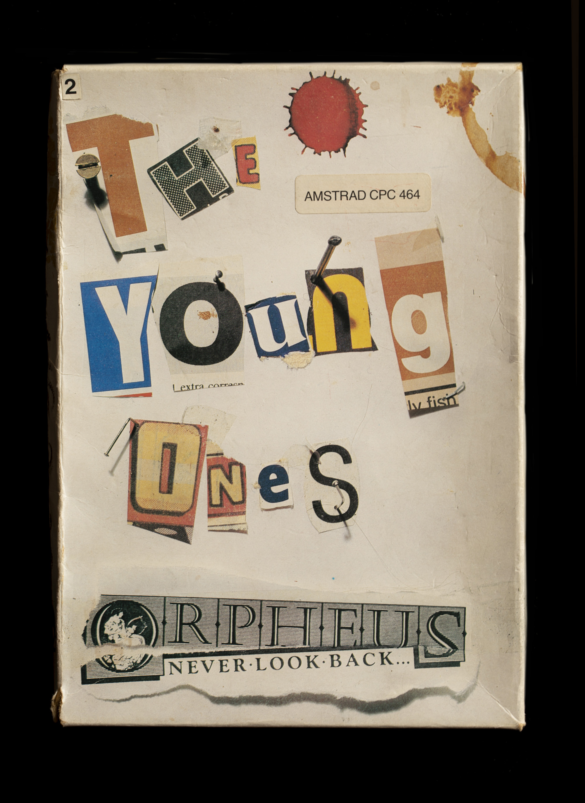 Front box design with newspaper cutout style lettering saying the young ones